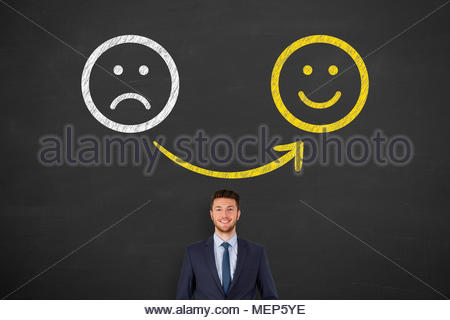 Unhappy and Happy Smiley on Blackboard Background - Stock Photo