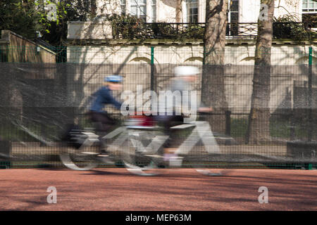 Cycling on The Mall in central London near Buckingham Palace - Stock Photo