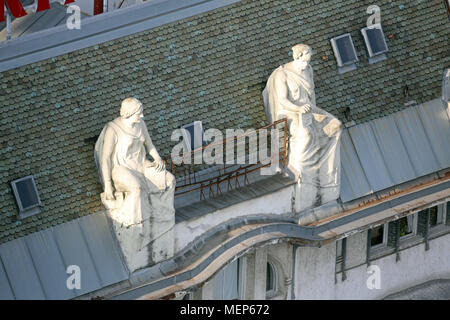 Statues on top of the old city buildings on Ban Jelacic Square in Zagreb, Croatia. - Stock Photo