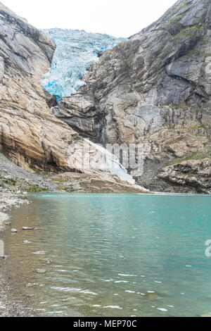 glacier Briksdalsbreen and its lake, Norway, arm of the Jostedal glacier, Oldedalen, Olden at the Nordfjorden, glacial ice on the shore - Stock Photo