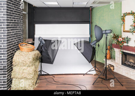 Interior studio with connected studio equipment, lighting and paper backgrounds - Stock Photo