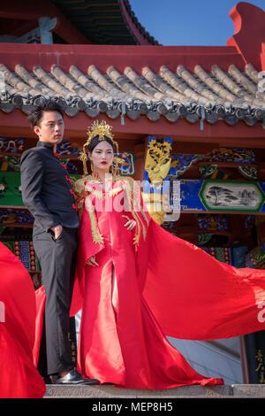 Chinese couple in front of Xinglin Pavilion, The Xiamen International Garden & Flower Expo Park, Jimei District, Xiamen, Fujian, China