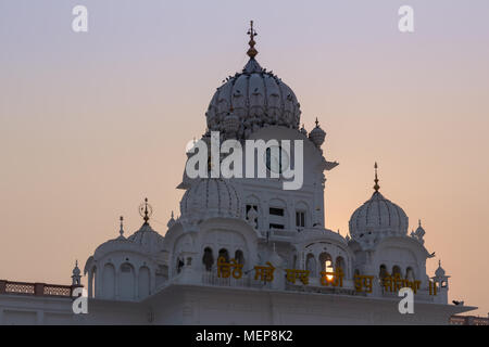 Sunset at the Clock Tower entrance to the Golden Temple,Sri Harmandir Sahib,  Amritsar, India - Stock Photo
