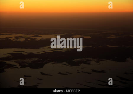 Lake Chad seen from the Airplane during a beautiful Sunset - Stock Photo