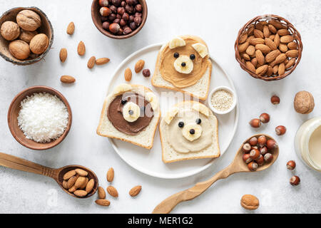 Nut butter banana toast for kids with animal face. Food art, healthy kids meal. Table top view. Healthy eating, healthy lifestyle, kids meal, kids men - Stock Photo