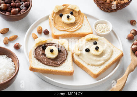 Vegan nut butter toasts with animal faces. Healthy breakfast for kids. Selective focus. Concept of vegan, healthy lifestyle, peanut butter banana, foo - Stock Photo