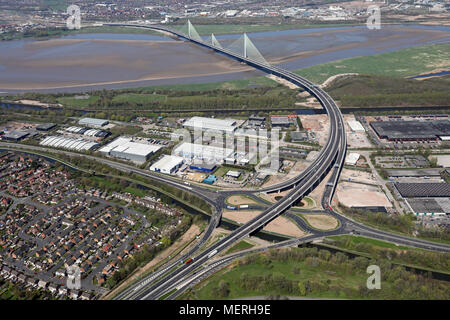 aerial view of the A533 road at Runcorn as it crosses the new Mersey Gateway cablestay bridge - Stock Photo