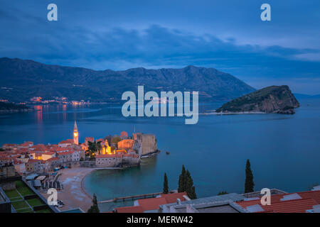 Dusk over the popular summer resort town Budva on the Adriatic coast in Montenegro - Stock Photo