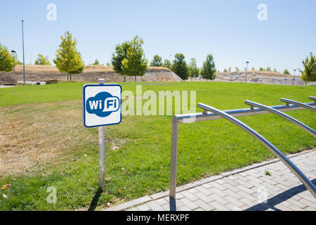wifi area signal and bicycle parking in urban park of Valdeluz town, near Guadalajara city, Spain, Europe - Stock Photo