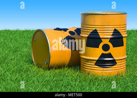 Barrels with radioactive waste on the green grass against blue sky, 3d rendering - Stock Photo