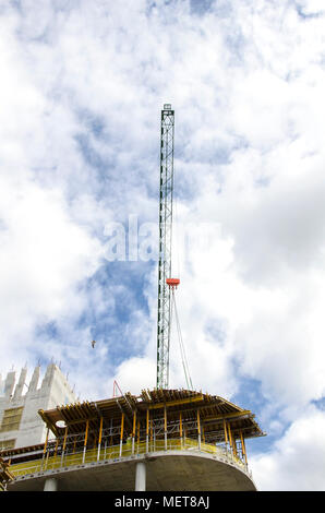 GLASGOW, SCOTLAND -SEPTEMBER 14th 2014: A crane working on a building site in the centre of Glasgow on a sunny day. - Stock Photo