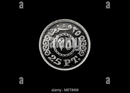 A macro image of a ten piastre coin from Egypt isolated on a black background - Stock Photo