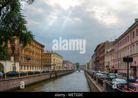 RUSSIA, SAINT PETERSBURG - AUGUST 18, 2017: View from the Bank Bridge on the embankment of the Griboedov Canal - Stock Photo