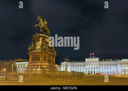 RUSSIA, SAINT PETERSBURG - AUGUST 18, 2017:  Monument to Nicholas 1 on St. Isaac's Square, night illumination, long exposure light - Stock Photo