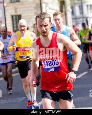 St James's Park, Birdcage Walk, London,UK. 22nd April, 2018. Elite and thousands of fun runners head towards Buckingham Palace in brilliant Spring sunshine as they enter the final mile of the 2018 Virgin London Marathon. Several of those taking part were affected by the one of the hottest Marathons days on record and needed the help of other runners to complete the final km as they approached the Mall whilst others were treated by first aid crews. Sadly one runner, Matt Campbell, aged 29, collapsed after 22.5 miles and died later in hospital . Credit: Alan Fraser - Stock Photo