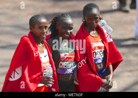 Tadelech Bekele (ETH, 3rd), Vivian Cheruiyot (KEN, 1st) and Brigid Kosgei (KEN, 2nd) at the end after crossing the finish line of the Virgin Money London Marathon.   Cheruiyot ran a perfectly judged race to take the title in the elite women's race and become the fourth fastest woman of all time over the gruelling marathon distance finishing in a time of 2:18:31.  Kosgei finished in second place with a time of 2:20:13, Bekele finished in third place with a time of 2:21:40. - Stock Photo