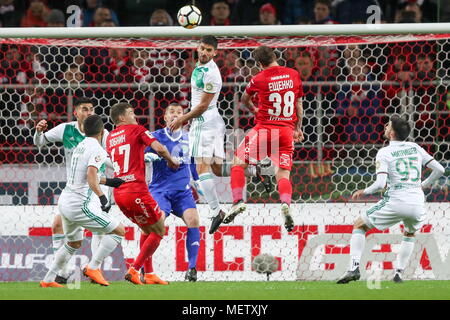 Moscow, Russia. 23rd Apr, 2018. MOSCOW, RUSSIA - APRIL 23, 2018: Akhmat Grozny's Ismael (L), goalkeeper Yevgeny Gorodov (blue), Milad Mohammadi (C), Magomed Mitrishev (R) and Spartak Moscow's Roman Zobnin (2nd L), Andrei Yeshchenko (2nd R) in action in their 2017/18 Russian Premier League Round 27 football match at Otkrytie Arena Stadium. Sergei Savostyanov/TASS Credit: ITAR-TASS News Agency/Alamy Live News - Stock Photo