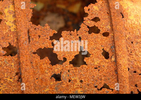 Close up of rusting metal that is exposed to sun and rain - Stock Photo