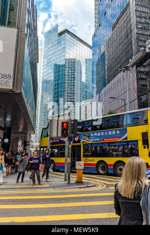 China, Hong Kong, 2018-03-13: Street in center of Hong Kong city downtown - stylish modern corporate buildings, business office of glass and metal. - Stock Photo