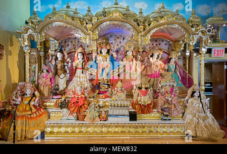 The altar with large statues of  Hindu Gods and Goddesses at the Shri Lakshmi Narayan Mandir temple in Richmond Hill, Queens, New York. - Stock Photo