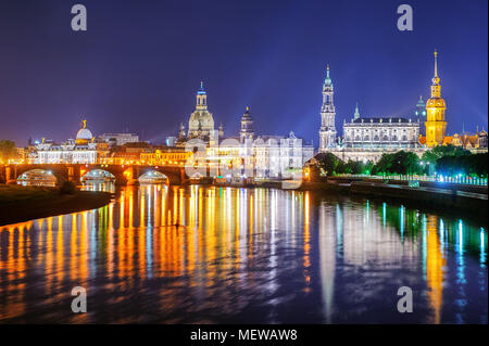 Panoramic view of the Dresden Old Town reflecting in Elbe river at late evening, Germany - Stock Photo