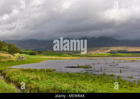 After heavy Summer rain the South Esk river broke its banks and flooded the Valley Floor of Glen Clova in the Angus Glens, Scotland. - Stock Photo