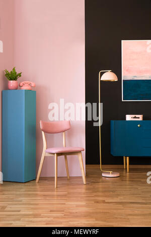 Plant on blue cupboard in cozy living room interior with green ...