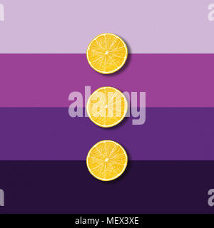 Three lemon fruit slices on electric purple background, abstract pop art picture - Stock Photo