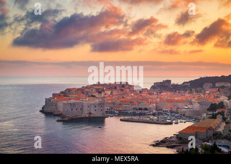 Panoramic aerial view of the historic town of Dubrovnik, one of the most famous tourist destinations in the Mediterranean Sea, at sunset, Croatia - Stock Photo