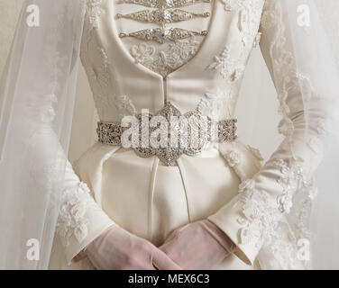 National costume of Caucasian bride. Close-up of a wedding dress. Wedding gown background. - Stock Photo