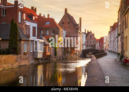 Classic view of the historic city center of Brugge, often referred to as The Venice of the North, in beautiful golden morning light at sunrise - Stock Photo
