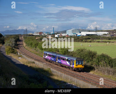 A Northern rail class 142 pacer train at  Ormsgill(Barrow in Furness) on the Cumbrian coast railway line - Stock Photo