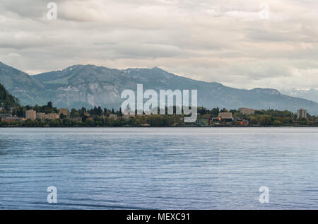 Lake Constance, Bodensee, at dusk against backdrop of mountains - Stock Photo