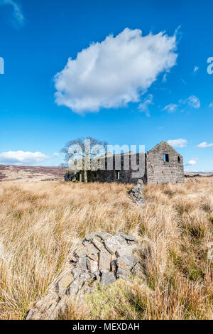 A derelict abandoned and Edwardian farmhouse on the moorland of Calderdale in West Yorkshire - Stock Photo