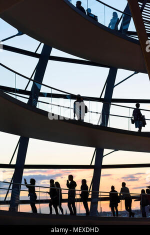 Berlin. Germany. Visitors to the Reichstag dome silhoutted against the sunset. - Stock Photo