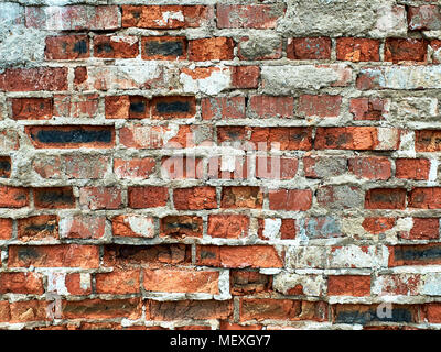 Very old, worn out red brick wall texture, background with some black and white pieces - Stock Photo