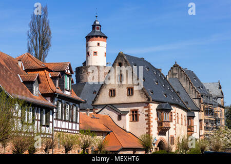 half-timbered house and Büdingen Castle in historic town centre of Büdingen, Hesse, Germany, Europe - Stock Photo