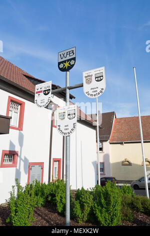 Sign of twin towns at the church square in Weisenheim am Berg, Rheinland-Pfalz, Germany, Europe - Stock Photo