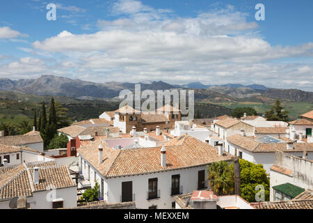 view from roof of the Iglesia de Santa Maria la Mayor church over the old town to the mountains of the Sierra de Grazalema, Ronda, Andalucia, Spain - Stock Photo