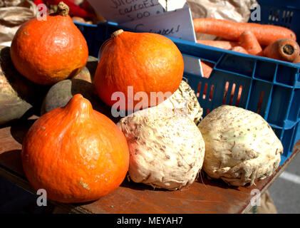 squashes and celeriac, part of a fresh vegetable display on sale at a weekly food market or farmers market. Skibbereen, ireland a popular market place. - Stock Photo