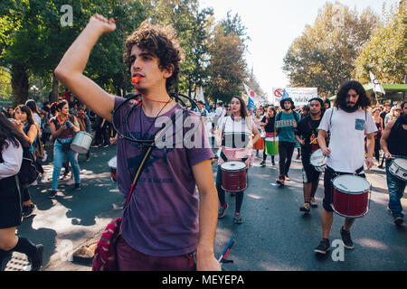 Santiago, Chile - April 19, 2018: Chileans marched through Santiago's streets, demanding an end to the Profit in the Education - Stock Photo