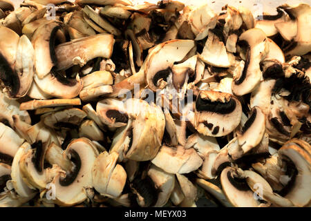 Cut field mushrooms ready to be used as ingredients in cooking Pizzas - Stock Photo