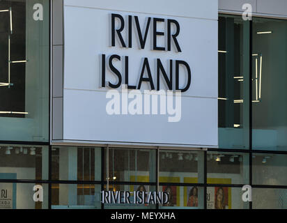 Sign above the entrance of the River Island store in the town's retail park - Stock Photo
