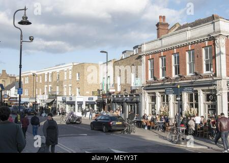 Shoppers stroll through Broadway Market on a sunny day in London, United Kingdom, October 29, 2017. () - Stock Photo