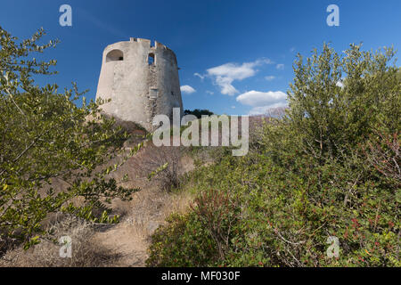 The vegetation of inland surrounds the tower Cala Pira Castiadas Cagliari Sardinia Italy Europe - Stock Photo