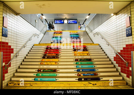 Colorful art stairs for passengers people walking up and down between terminal platform at Mannheim Hauptbahnhof railway station on August 29, 2017 in - Stock Photo
