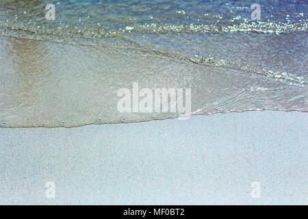 A close-up of a wave on the sand - Stock Photo