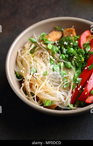 Noodles with fried chicken and vegetables, food closeup - Stock Photo