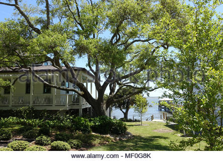 A peak of the ocean between homes in a Southport, North Carolina neighborhood - Stock Photo