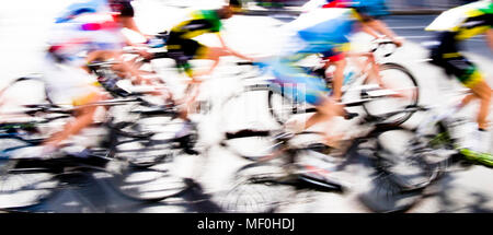 Abstract arty background : motion blur of young bicycle racers competing on city streets - Stock Photo